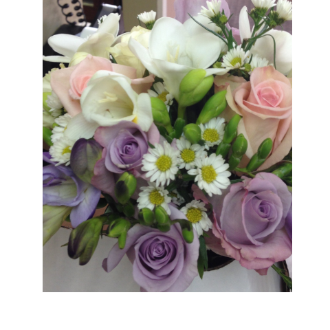 Lavender and peach roses with freesia bouquet