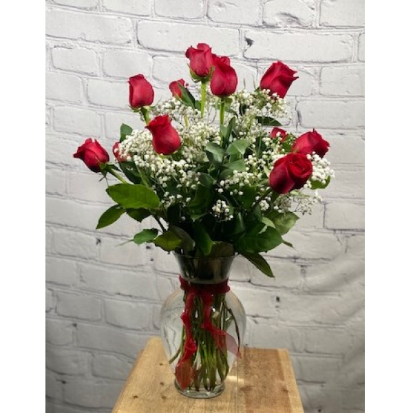 One dozen long stem roses with baby breath
