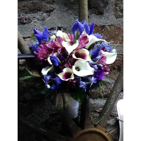 Calla lilies, roses and iris bridal bouquet