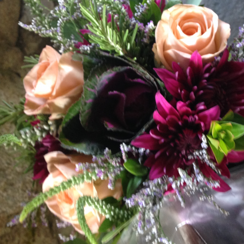 Purple cabbage, peach roses and purple mums and limonium fall bridal bouquet