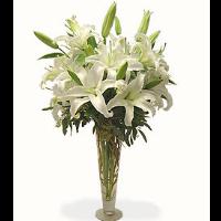 Elegant Vase Of White Lilies