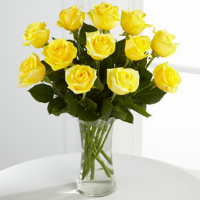 One Dozen Yellow Roses In Glass Vase