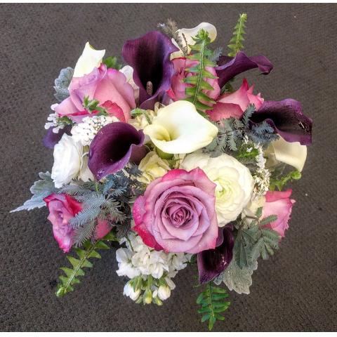 Beaverton Florists Beaverton - Eggplant, lavender, white tones with fern accents.