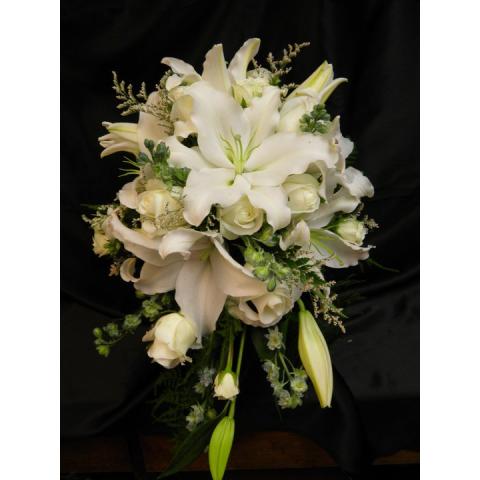 Beaverton Florists Beaverton - Wispy, classic white cascading lilies and roses.