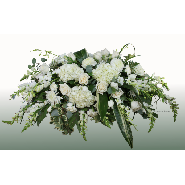 Beaverton Florists Beaverton - Elegant and exquisite casket piece with a seasonal selection of all white flowers. Hydrangea, roses, chrysanthemums and snapdragons, with soft greenery.