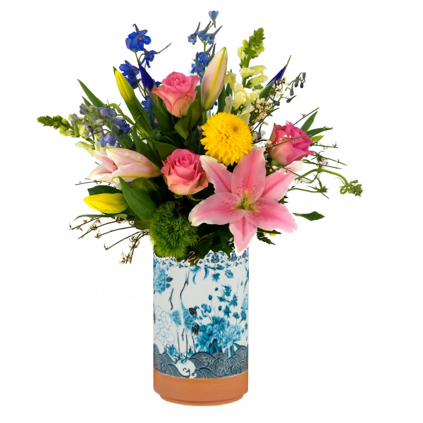 Beaverton Florists Beaverton - Like in a enchanted garden, Eden features a bright but delicate selection of Spring flowers. Fragrant Stargazer lilies, bright tulips and elegant delphinium are some of the flowers in our garden style bouquet arranged in an elegant ceramic vase .