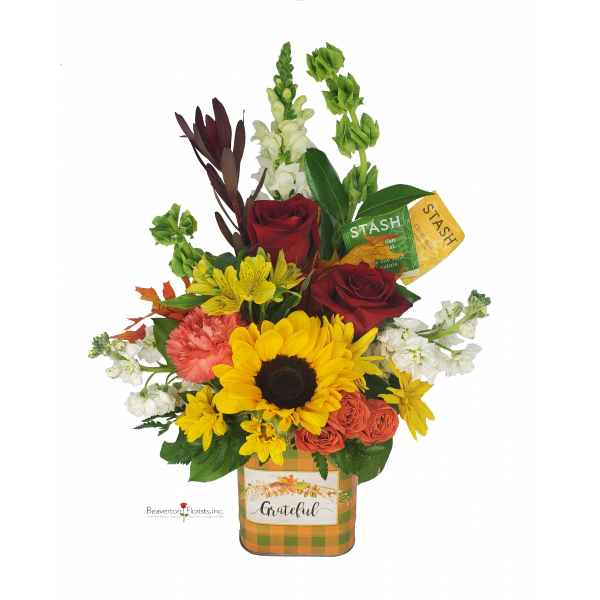 Beaverton Florists Beaverton - Fall is the perfect time of the year to enjoy a warm cup of tea while enjoying the beauty of fresh flowers. This arrangement features a sunflower, carnations, roses and much more.  Brighten someone's day, or afternoon with this one of a kind arrangement.   *** Container pattern may vary. *** Seasonal Tea.