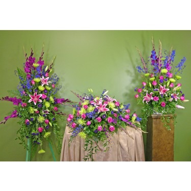Beaverton Florists Beaverton - <p>This collection of striking flowers arranged in a sympathy setting will lighten the heart and create a lasting memory of your loved one.</p><br /> <p>You can order individual pieces or choose the entire display.</p><br /> <p>The<strong> Arrangement</strong> is suitable for on the floor or on a stand. It is $236.95</p><br /> <p>The <strong>Standing Easel Spray</strong> is on a Wire easel that is traditionally left at the graveside after the service. It is $314.95</p><br /> <p>The <strong>Casket Spray</strong> is to be placed on top of the casket for the service. It is $393.95</p><br /> <p><strong>Note: You save $50 when you order all three pieces.</strong></p>