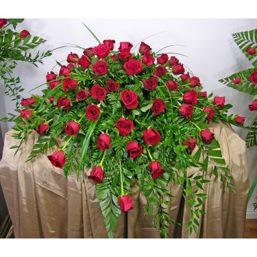 Beaverton Florists Beaverton - This lovely Casket Spray of 60 red roses is a very elegant tribute.<br /> <br /> Available in Pink, White, Yellow, Lavender, Orange and other colors if ordered in advanced. Call for more choices.