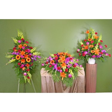 Beaverton Florists Beaverton - <p>Hot pinks, reds, yellows, Oranges and lavenders all combine in the Garden In Spring Sympathy Set to create the feeling of a garden starting to bloom.</p><br /> <p></p><br /> <p><strong>Note: You save $50 when you order all three pieces.</strong></p>