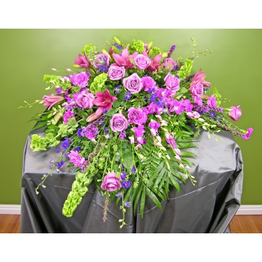Beaverton Florists Beaverton - This collection of all lavender flowers will enhance the casket.