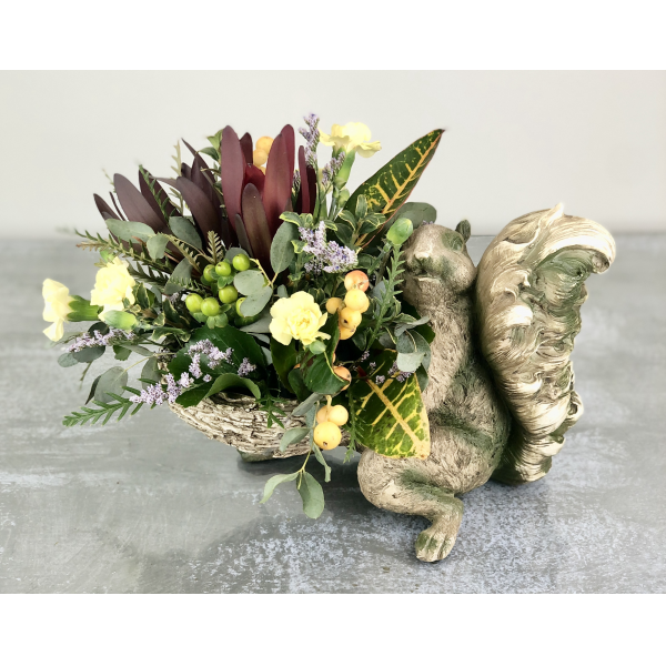 K&K Interiors Sitting Squirrel with Fall Collection of Flowers