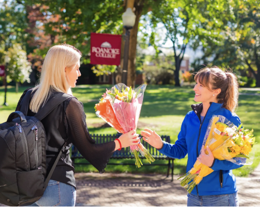 Lady sharing flowers at Roanoke College