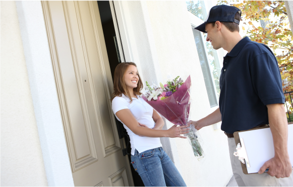 Lady thanking delivery driver.