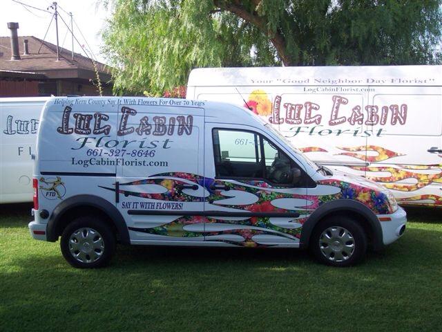 Log Cabin Delivery Vans