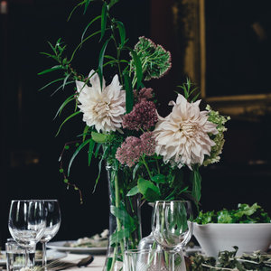 Flowers and Wine Glasses on Table