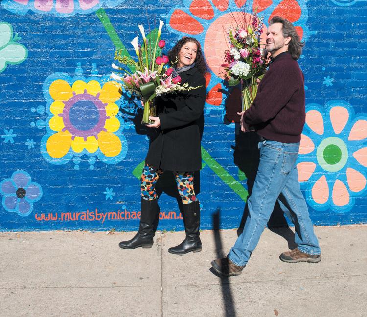 Larry & Lea Walking Besides Flower Mural