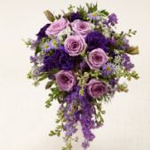 The FTD® Lavender Garden™ Bouquet is blooming with majestic charm, set to add that extra touch to your wedding style. Lavender roses are offset by purple larkspur, purple double lisianthus, lavender monte casino asters and Queen Anne's Lace to create a fantastic display of floral beauty and elegance Approx. 20 x 10