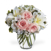 The Campbell...a light palate of pinks and whites that include roses and lilies all designed in a ginger jar style vase.