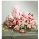 The Teddy Casket spray can be done in pink or blue.