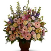 The Loving Grace Sympathy arrangement can be designed in a variety of sizes.  Shown is our Deluxe size.  Colors can be varied to suit any preference. This is a stunning floral piece that is certainly going to stand out at a service