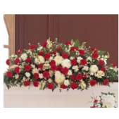 The Traditional Casket cover is designed for a closed casket.  A smaller size is available for a viewing with an open casket.  Prices start at the open casket size.  Color can be varied depending on personal preference.  This spray features carnations and mums.