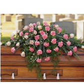 """The Carnation Casket spray can be done in a variety of sizes.  Close casket is the deluxe version shown.  The """"open"""" Casket version is the starting price.  Color of carnations can vary depending on personal preference."""