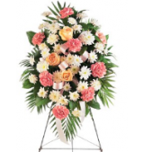Mixed Flower standing sprays can combine any combination of flowers and colors.  The pictured spray features carnations, roses and mums.