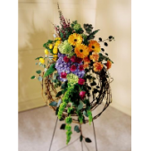 The Everlasting Grapevine Wreath features a large variety of seasonal flowers and can be designed to fit any color preferences.  This wreath stands aprox 5
