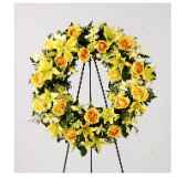 Our standing wreath is shown in yellow.  Our designers can use any variety of flowers to create a unique memorial piece.  A picture can be placed inside the wreath for a memorial focal point.  (family needs to provide a waterproof picture should one be desired)