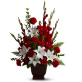 The Faithful Tribute Sympathy Arrangement is a bold statement featuring Reds and whites.  Lilies, Carnations, Gladiolus,