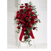The Red Rose Standing Spray features Freedom roses arranged on an easel.  This spray stands 5