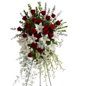 Our Orchid and Rose Splendor Standing Spray is a corporate statement.  It features roses, lilies, roses and exotic greens all arranged on an easel.  This freestanding spray measures 6 ft tall.
