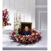 The Memorial Picture Wreath is set on a table in the front of the church or chapel during the service.  A picture can be placed within the wreath should the family desire and provide.  Colors and style can vary.