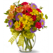 The Make a Wish....for the person who is wishing you'd send a bright mixed arrangement in a glass ginger jar vase.