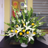The Memorial Tribute Sympathy Arrangement can be done is a variety of colors.  This style arrangement is appropriate for both memorial services or traditional services.  Local funeral homes provide a stand when the funeral home director places the arrangement in the chapel.