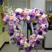 A warm and beautiful heart shaped standing heart with  Hydrangeas, carnations, roses, mums and orchid clusters