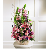 The Floral Memory Basket is a contemporary arrangement of lovely flowers arranged in a basket.  This bouquet can be used at the traditional funeral service or a memorial service.  It is a sympathy gesture that can be sent to the funeral home, church chapel or family home.