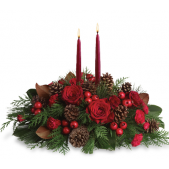 <b> The Spirit of the Season Centerpiece come with one, two or three taper candles; with roses, berries, cones and carnations..  Size varies with the addition of the candles.   <br> <br> Prices range from...  <br>$74.95 for the single taper    <br> $89.95 for a double candle.  <br> $99.95 for a triple candle.