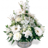 The Winter Wonderland shimmers with silvers and white tones.  Flowers are artfully arranged in a basket.  Seasonal favorites are included.  This is a one sided arrangement