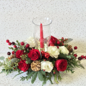 Our exclusive candle lamp centerpiece includes a cut glass hurricane lamp with a single taper candle.  Filled with the flowers of the season, the cedar and fir greenery add the scent of Christmas to any table!