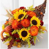 The Grand Cornucopia.  The perfect touch to a Thanksgiving table.  This centerpiece contains Sunflowers, gourds, roses, baby euc and fall leaves.  As shown, deluxe and premium pricing reflects the size of the arrangement and the number of fresh floral product used to create the bouquet.