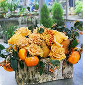 Our Casual Gathering Centerpiece features roses with gourds in fall tones. Elegant yet casual, this centerpiece compliments a holiday table very well.