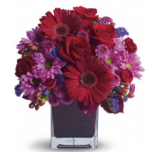 Fremont Flowers Red Hot Bouquet!  Romantic flowers arranged in a glass cube.  A Valentine's favorite!  This bouquet comes in a red cube vase!