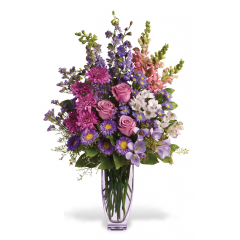 All their wishes will come true when they receive this ELEGANT and showy vased  arrangement - a seasonal mix of purple asters, lavender roses, pink snap dragons, alstroemeria and more, Send one today, and make someone's day!