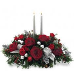 <b> The Silver Glow Centerpiece, great traditional gift for the holiday season.  <br> <br> As shown, deluxe and premium pricing reflects the size of the arrangement and the number of fresh floral product used to create the bouquet.