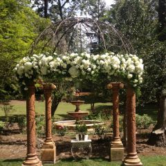 Our creative wedding designer Randy Pinto create beautiful weddings!  Pictured is a custom arch floral creation where Randy placed Roses, Hydrangea, lavish greens and spring filler on an arch in the sunken gardens at Palmdale Estates.