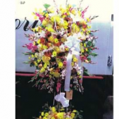Bright summer colors in a wonderful arrangement, this standing spray has florals both on top and on the bottom.  It is a magnificent display that measures 6 ft tall.  This display is courtesy of Superior Florist, in Manhatten, NY...one of the Best Real Local Florists in New York.