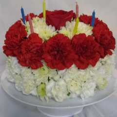 The Beautiful Wishes™ Floral Cake is set to celebrate their birthday with sweet sentiments blooming with chrysanthemums and carnations. Perfectly arranged in the shape and styling of a colorful birthday cake incorporate chrysanthemums, button poms, pale yellow carnations and mini carnations. Presented on a white cake plate, this memorable flower arrangement will add to the festivities of their special day. Please know that each floral cake will vary.