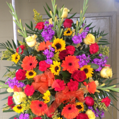 A fitting tribute to those Who lived a vibrant life. The Standing Colorburst celebrates such a life with its vibrancy. A colorful mix of seasonal flowers make this tribute stand out.  As shown $229.95  Deluxe version is $299.95